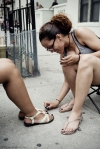 painting toe nails on the sidewalk