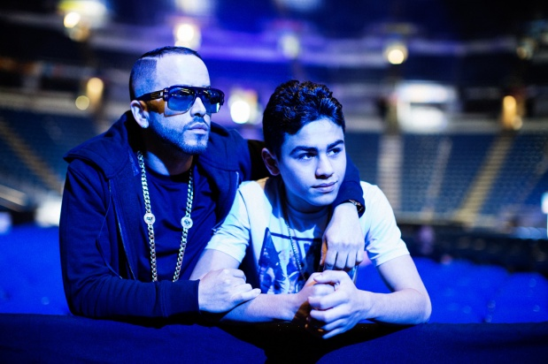 yandel with his son approving the final tweaks to the stage before his sold-out concert